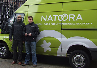 Balsa and Robert with an early Natoora branded van