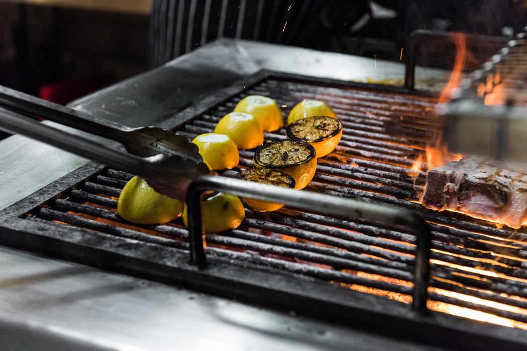 Charring lemons on the grill